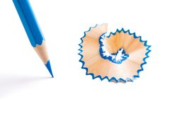 Blue Color pencil. And shaving on white background royalty free stock photography