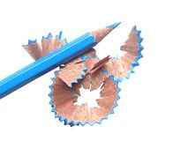 Blue color pencil and shavings. Blue color pencil and shaving on white background royalty free stock photo