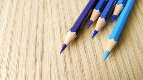 Blue color pencils. On wooden board for background usage royalty free stock photos