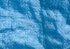blue color plastic bag surface with blur effect. Royalty Free Stock Photo