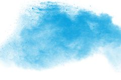 Blue color powder explosion. Cloud isolated on black background stock photos