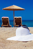blue color of sea and hat on sand Stock Photography