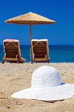 Blue color of sea and hat on sand Stock Photos