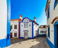 Blue color on the sky and buildings of old city Ericeira. Portugal royalty free stock photos
