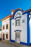 Blue color on the sky and buildings of old city Ericeira stock image