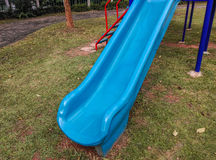 Blue color slide. In the playground stock image