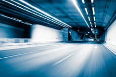 Blue color tunnel car driving motion blur Royalty Free Stock Image