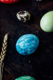 Blue colored easter egg similar to planet Earth Royalty Free Stock Photos