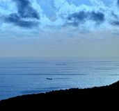 Blue colored image at dawn on the coast. Blue colored image at dawn on the sea Royalty Free Stock Images