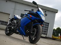 Blue colored new motorbike Royalty Free Stock Image