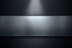 Blue colored perforated metal plate with polished metal plate ba Royalty Free Stock Photo