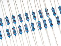 Blue colored resistors. Close up group of blue color electronic resistors on a white background Stock Photography
