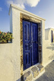 Blue colored wooden door of a house in Santorini Island Stock Images