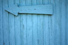 Blue color wood wall. Blue colored wooden wall with a big arrow on it Royalty Free Stock Images