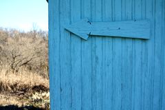 Blue color wood wall. Blue colored wooden wall with a big arrow on it Stock Photos