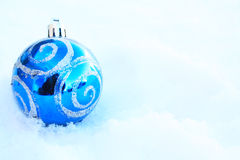 blue Colorful Christmas ball in snow Stock Photo