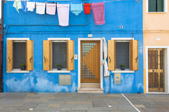 Blue colorful house of Burano Island with laundry, Venice, Italy Royalty Free Stock Images