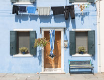 Blue colorful house of Burano Island with laundry, Venice, Italy Royalty Free Stock Photo