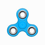 Blue colorful spinner on a white background.. Hand fidget blue spinner toy - stress and anxiety relief. Blue colorful spinner on a white background. Modern Royalty Free Stock Photography