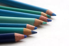 Blue Coloring Pencils. Coloring pencils of blue hues on white background Royalty Free Stock Images