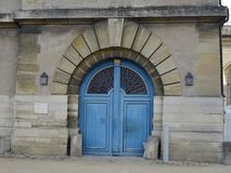 Blue colour manor door at Chateau de Vincennes - France. Discovered this blue door whilst exploring the outside area of the historic castle for scenes of art and Royalty Free Stock Photo
