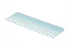 Blue Comb on white background Royalty Free Stock Photos