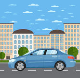 Blue comfortable sedan on road in city Royalty Free Stock Images