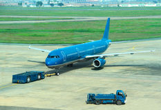 Blue commercial airplane Royalty Free Stock Photography