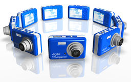 Blue Compact Camera. Circle of photo cameras 3d isolated Stock Photo
