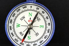 Blue compass on black background stock image