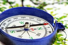 Blue compass directional device stock photo