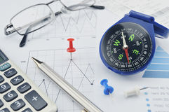 Blue compass, pen and pin on graph paper Royalty Free Stock Images