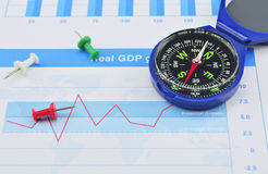 Blue compass and pin on graph paper, success concept Stock Photos