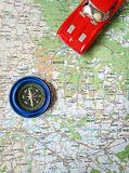 Road map and toy car on the map. A blue compass road map and a red toy car on the map follow the route to the city Royalty Free Stock Photo