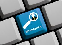 Computer Keyboard: Staff german. Blue Computer Keyboard with Magnifier Symbol showing Staff in german language Royalty Free Stock Images