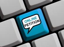 Speech Bubble on Computer Keyboard showing Online Petition. Blue Computer Keyboard with speech bubble showing Online Petition stock image