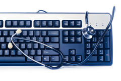 Blue computer keyboard with stethoscope Royalty Free Stock Images