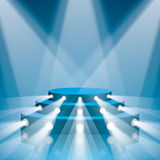 Blue concert scene with projector lighting. Royalty Free Stock Image