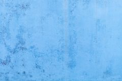 Blue concrete wallpaper with water marks running down stock photo