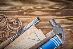 Blue construction drawing claw hammer firmer chisel wooden studs Royalty Free Stock Photos