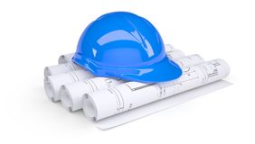 Blue construction helmet on the rolls of drawings. Blue construction helmet on the rolls of architectural drawings.  on white background Royalty Free Stock Images