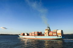 Blue container cargo ship at sea Royalty Free Stock Photos