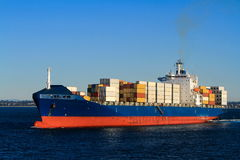 Blue container cargo ship at sea Stock Images