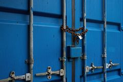 Free Blue Container Door With Rusty Chain And Locked Padlock Royalty Free Stock Images - 113119339