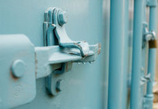 A blue container lock. Close-up of a blue container lock with some water droplets Royalty Free Stock Photography