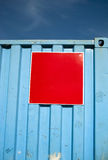 Blue container with red square Stock Photos