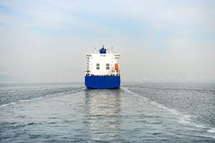 Blue container ship cruising at sea. The blue container ship cruising at sea stock photo