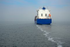 Blue container ship cruising at sea. The blue container ship cruising at sea stock photos