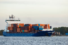 Blue container ship. Moving to Baltic sea. Riga, Latvia royalty free stock image