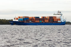 Blue container ship Stock Images